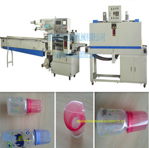 China Factory Price Automatic Feeding Bottle Shrink Wrapping Machine pictures & photos