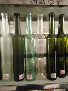 Screen Printing Surface Handling and Cork Sealing Type Glass Wine Bottle 750ml pictures & photos