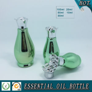 Green Electroplate Single-Gourd Shape Glass Essential Oil Bottle with Flower Cap pictures & photos