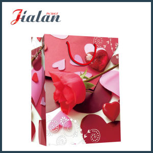 Glossy Laminated Ivory Paper Valentine′s Day Roses Gift Paper Bag pictures & photos