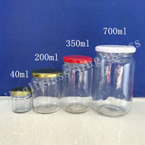 Wholesale Small Jar and Large Jar/200ml 350ml 500ml 700ml Round Glass Jars with Lids pictures & photos