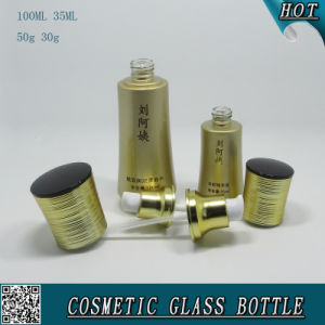 Gold Colored Cosmetic Glass Bottle and Glass Cream Jar pictures & photos