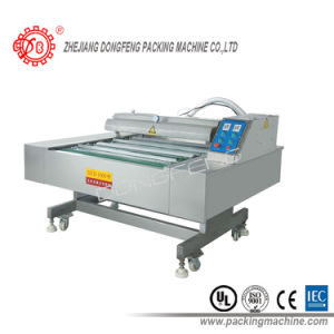 PLC Control High Quality Full Automatic Vacuum Packing Machine (DZD-1000) pictures & photos