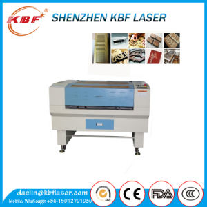 Promotional High Speed Clothes Wood CO2 Laser Cutting Machine pictures & photos
