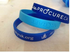 Debossed Color Filled Rubber Wrist Bands Cheap Bracelet Custom Silicone pictures & photos