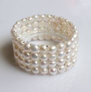 4 Rows Elastic Coin Shape Freshwater Pearl Bracelet (EB1583) pictures & photos