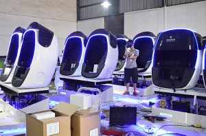 Robot Shape Cool Design High Definition 9d Vr Cinema Simulator, Owatch 9d Vr Chair with Double Seats pictures & photos