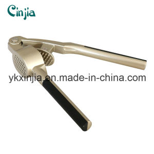 Kitchenware High Quality Soft Handle Stainless Steel Garlic Press pictures & photos