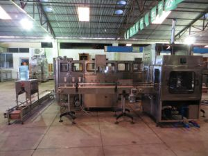 600bottle/Hour Bottle Washing & Filling Equipment (XG-600-L) pictures & photos