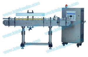 Full Automatic Bottled Milk Aluminum Foil Sealing Machine (IS-100A) pictures & photos