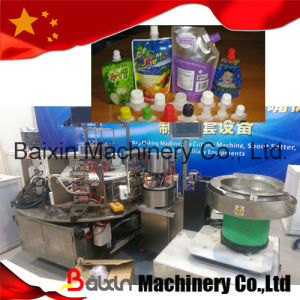 Automatic Plastic Pouch Spout Mouth Inserting Machine Chinaplas pictures & photos