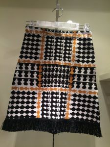 Lady′s Knitted Skirt with Tassels