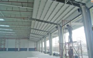 Made in China Overhead Sectional Door with Competitive Price Lifting up Workshop Powered Control Overhead Door (Hz-SD013) pictures & photos