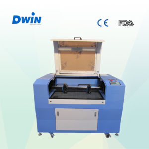 Hot Sale 6090 CNC CO2 Laser Engraving Cutting Machine pictures & photos