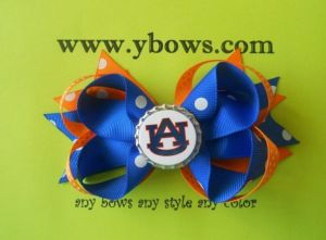 Blue and Orange Ribbon Bows, With a Bottle Cap in The Middle
