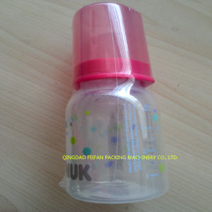 China Factory Price Automatic Baby Bottle Shrink Wrapping Machine pictures & photos