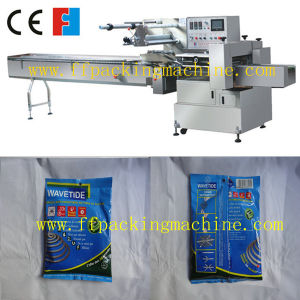 Full Automatic Coil Pillow Packaging Machine pictures & photos