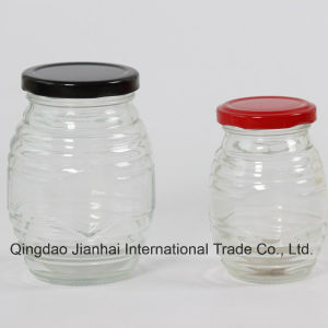 Same Design (150ml&300ml) Oval-Shaped Glass Honey Jar pictures & photos