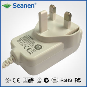 12W UK Power Adaptor/ Charger (RoHS, efficiency level VI) pictures & photos