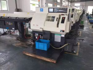 Bx42c Shanghai Mitsubishi M70A Control System with Three-Jaw Chucks CNC Lathe Machine pictures & photos