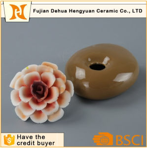 Aroma Stone Jar Ceramic Perfume Bottle with Flower Cap pictures & photos
