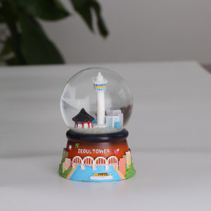 Nice Building Tower Design Resin Snow Water Globe with Music pictures & photos