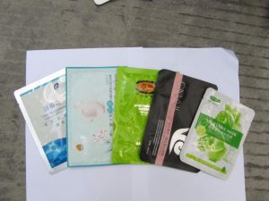 China High Speed Muti Function Filling Sealing Mask Bagging Machine pictures & photos