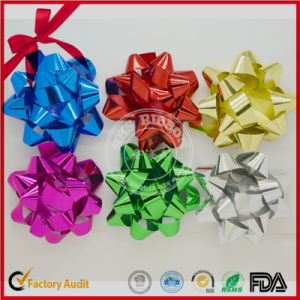 Iridescent Star Bow for Christmas or Weeding pictures & photos