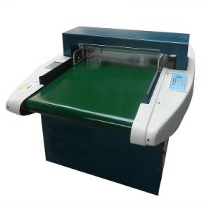 Textile Needle Detector. Garment Metal Detector Witnesses Calibration pictures & photos