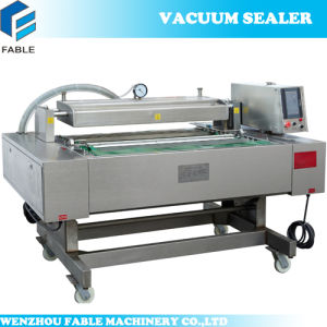 PLC Control High Quality Full Automatic Vacuum Packaging Machine (Dz1000) pictures & photos