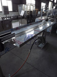 Packing Table/Accumulating Table for Aerosol Can (QGQ) pictures & photos