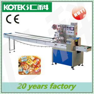 High Speed Pillow Type Packing Machine for Milk Tablet Milk Slice/Milk Powder Candy pictures & photos