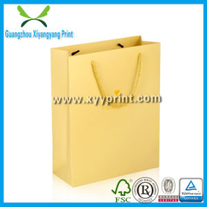 Wholesale Cheap Luxury Shopping Kraft Paper Bag with Logo pictures & photos