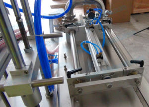 Semi-Automatic Two Nozzles Filling Machine with Work Table for Salad Sauce (FLC-250S) pictures & photos