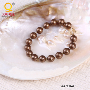 2014 Fashion Shell Bead Crystal Bracelet (BR125169) pictures & photos