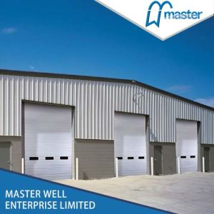 Easy Lift Industrial Overhead Sectional Door for Factory pictures & photos