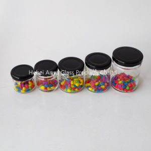 Wholesale Small Size Round Glass Bottle for Honey Preserve Canning Jar with Black Lid pictures & photos