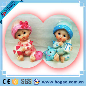 Beautiful Polyresin Baby Figurine with Lovely Cap pictures & photos