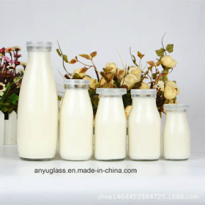 100ml, 250ml, 500ml, 1000ml Clear Round Milk Glass Bottles with Plastic Lid pictures & photos