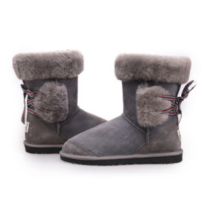 Double Face Sheepskin Winter Boots for Women with Bow Knot pictures & photos