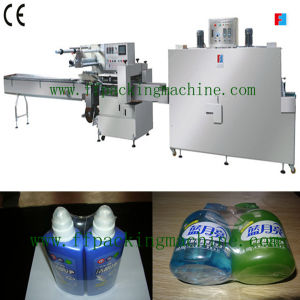 Automatic Bottle Shrink Packing Machine for Shampoo Bottle/Cosmetic Bottle pictures & photos