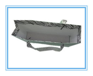OEM Comstom Paper Bag with Silk Ribbon pictures & photos