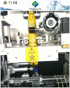 Wonderful Automatic Shrinking Labeling Machine / Equipment / Line pictures & photos