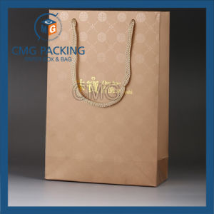 Golden Color Kraft Handle Paper Bag with Shiny Logo (DM-GPBB-186) pictures & photos