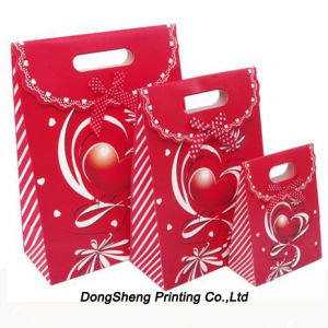 Beautiful Design of Paper Gift Packing Bag with Ribbon Accessories pictures & photos