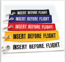 Custom Embroidery Fabric Keychain, Remove Before Flight Key Chain pictures & photos