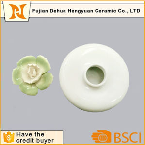 White Glazed Ceramic Perfume Bottle with Flower Cap for Sale pictures & photos