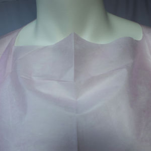 Die Cut Pink Non-Woven Isolation Gown with Thumb Loop pictures & photos