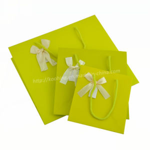 Shopping Packaging Bag with Handle/Beautiful Green Paper Handbags with Bow pictures & photos