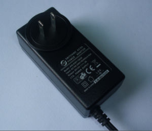 EU/UK/Us Plug 12V 2A (2000mA) Switching Power Adapter pictures & photos